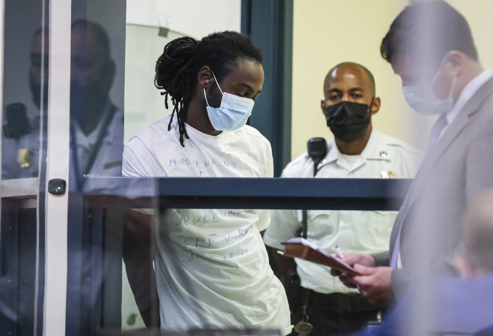 Conrad Pierre is arraigned at the Malden District Court on July 7,  2021 in Medford, Mass. Pierre is one of  11 people charged in connection with an armed standoff along a Massachusetts highway last weekend. (Erin Clark/The Boston Globe via AP, Pool)