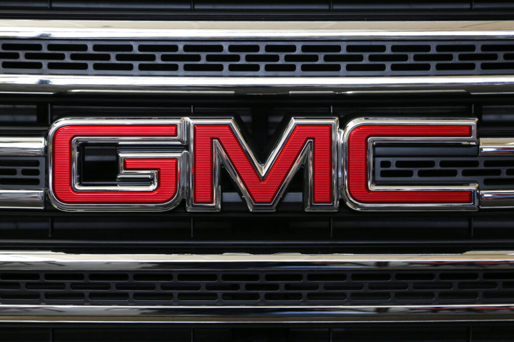 The GMC logo on display at an auto show in Pittsburgh in 2016. General Motors is recalling more than 400,000 pickup trucks in the U.S. because the side air bags can explode without warning and spew parts into the cabin. (Gene J. Puskar/AP)