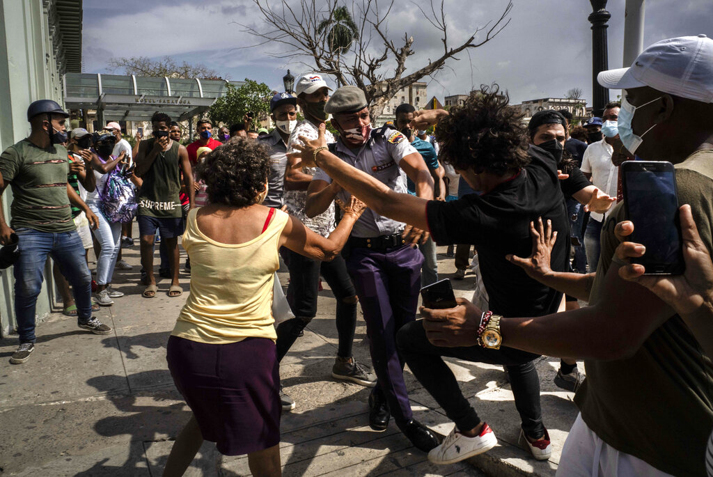 Police scuffle and detain an anti-government demonstrator during a protest in Havana, Cuba, on Sunday, July 11. (Ramon Espinosa/AP)
