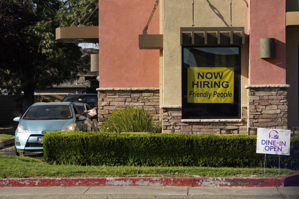 A hiring sign hangs in the window of a Taco Bell in Sacramento, Calif., July 15, 2021. (Rich Pedroncelli/AP)