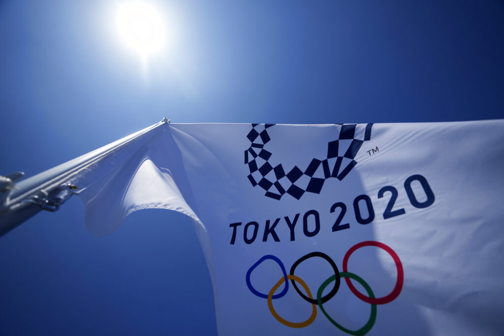 A Tokyo 2020 Olympic flag flies over the bleachers at Ariake Tennis Center in Tokyo. (Kiichiro Sato/AP)