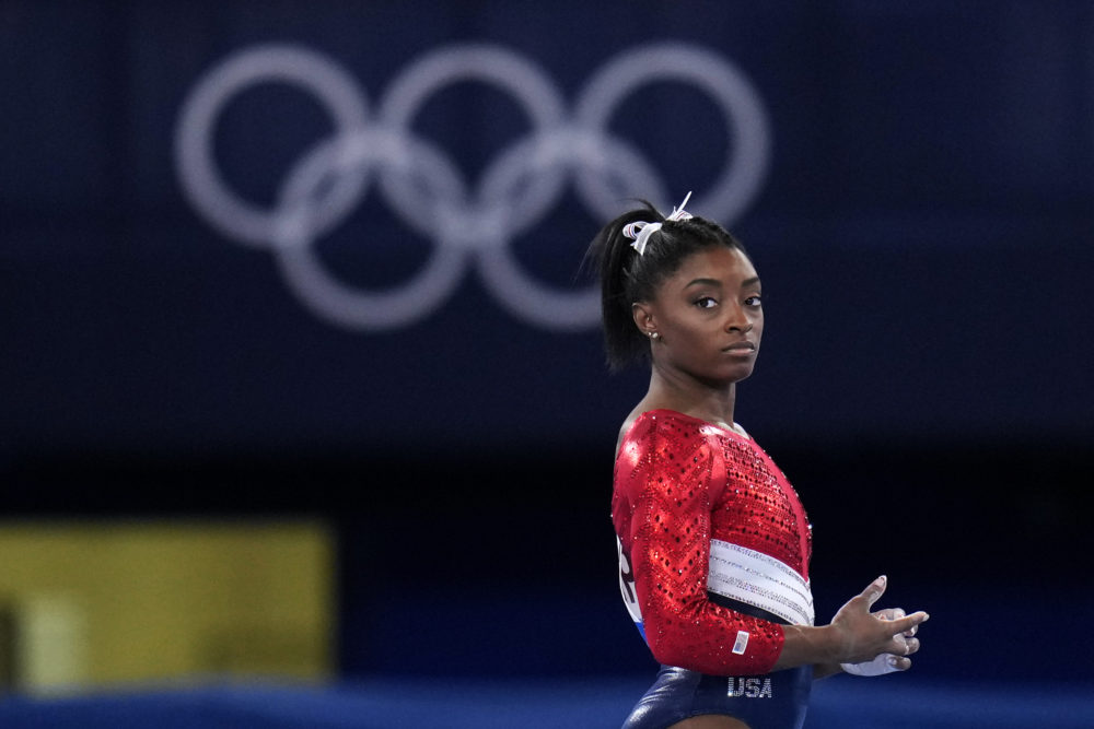 Simone Biles waits to perform on the vault during the artistic gymnastics women's final at the 2020 Summer Olympics, Tuesday, July 27, 2021, in Tokyo. (Gregory Bull/AP)