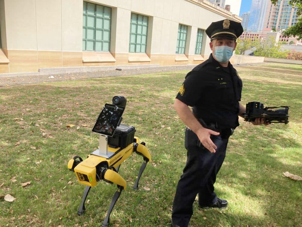 Honolulu Police Acting Lt. Joseph O'Neal demonstrates a robotic dog developed by Boston Dynamics in Honolulu, May 14, 2021. (Jennifer Sinco Kelleher/AP)