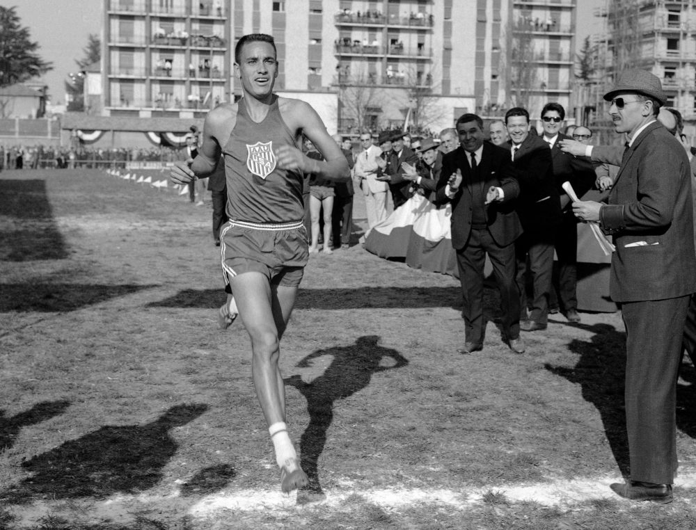 American Olympic gold medalist Billy Mills running in 1965. (AP Photo)