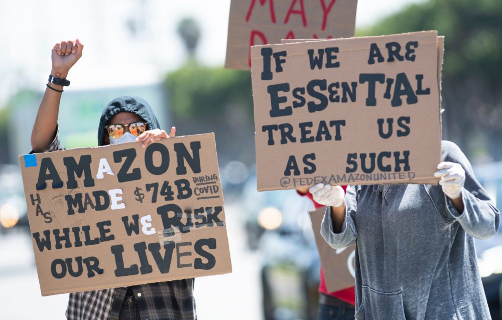 Workers protest against the failure to provide adequate protections, in May. (VALERIE MACON/AFP via Getty Images)