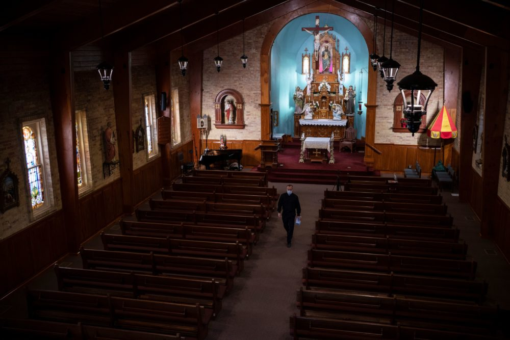 Father Christopher WIlliams walks down the aisle in the Basilica of San Albino on May 2, 2020 in Mesilla, New Mexico, amid the coronavirus pandemic. (Paul Ratje / AFP via Getty Images)