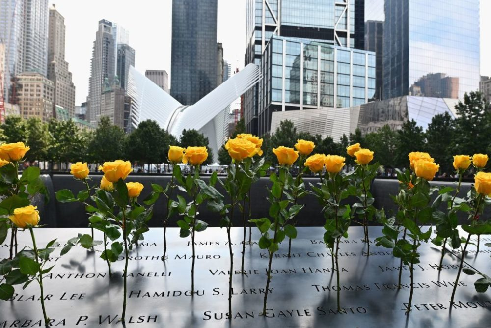 Flowers are placed at the 9/11 Memorial and Museum in New York on Sept. 11, 2020, as the U.S. commemorates the 19th anniversary of the 9/11 attacks. (Angela Weiss/AFP/Getty Images)