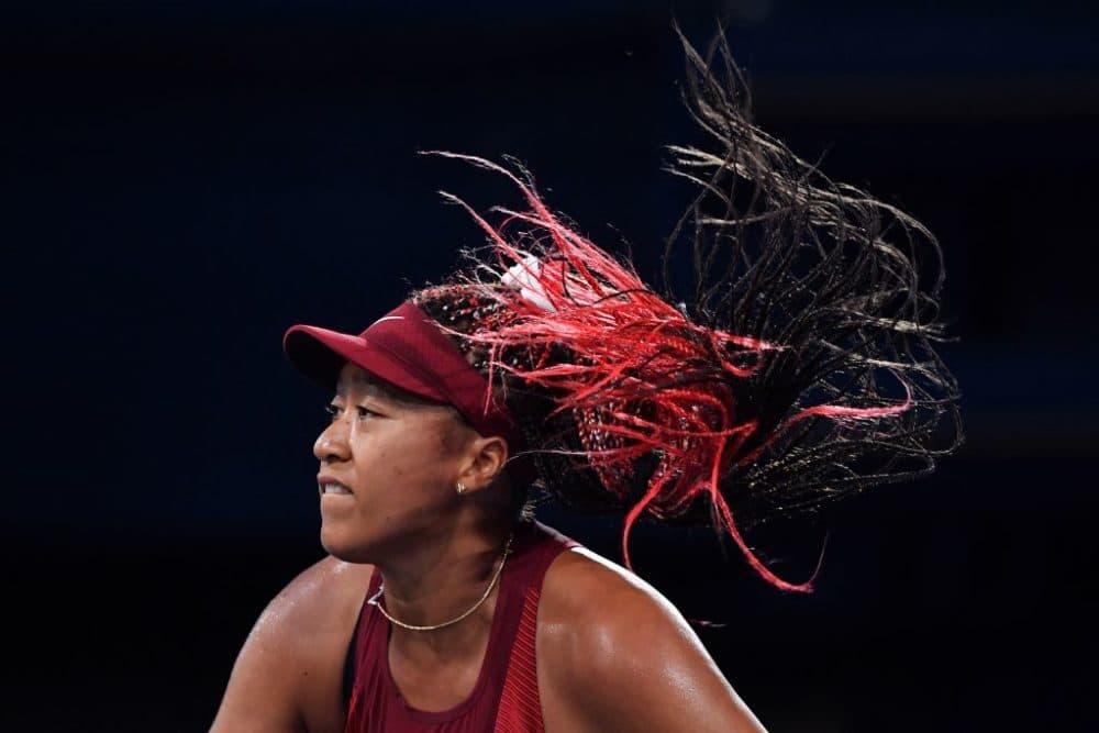Japan's Naomi Osaka returns the ball to Czech Republic's Marketa Vondrousova during their Tokyo 2020 Olympic Games women's singles third round tennis match at the Ariake Tennis Park in Tokyo on July 27, 2021. (Tiziana FABI / AFP via Getty Images)