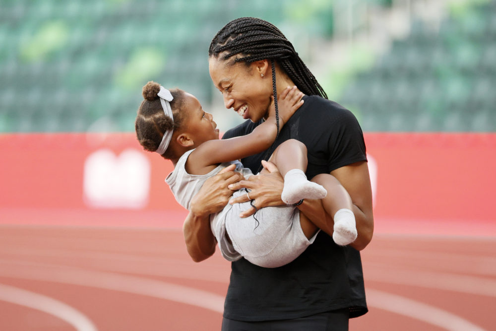 Allyson Felix celebrates with her daughter Camryn after day nine of the 2020 U.S. Olympic Track & Field Team Trials at Hayward Field on June 26, 2021 in Eugene, Oregon. (Steph Chambers/Getty Images)