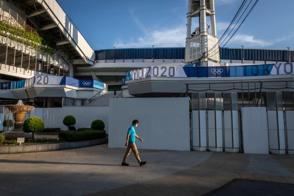 A man walks past the Yokohama Stadium, one of Tokyo Olympics venues on July 22, 2021 in Yokohama, Japan. (Yuichi Yamazaki/Getty Images)