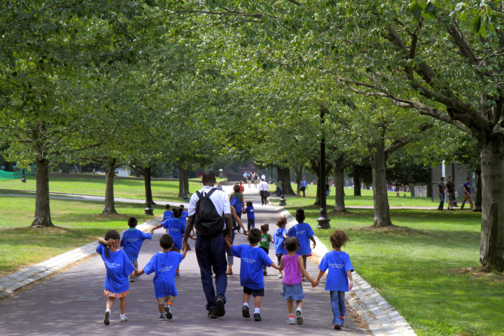 A daycare class walking in a public park in Boston Common. (Jeffrey Greenberg/Universal Images Group via Getty Images)