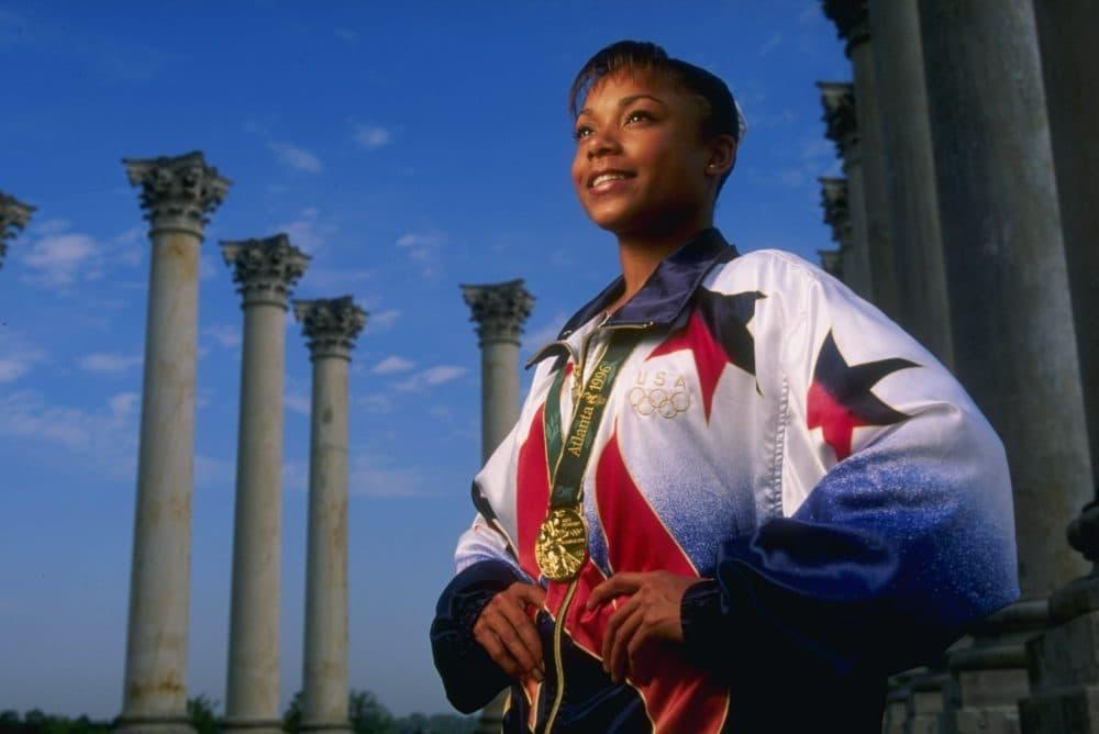 Gymnast Dominique Dawes of the USA, a medalist at the 1996 Centennial Olympic Games in Atlanta, Georgia, poses outside Washington, D.C. (Doug Pensinger/Allsport)