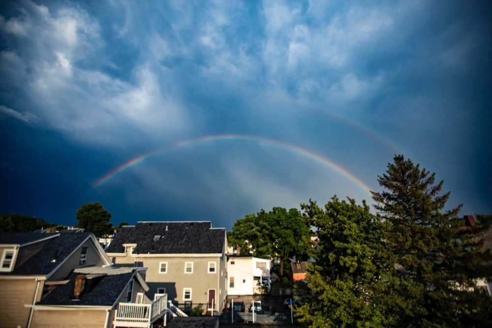 What was almost a double rainbow was seen over East Somerville on Wednesday evening, after afternoon storms. More rain is expected Thursday and into the holiday weekend. (Jesse Costa/WBUR)