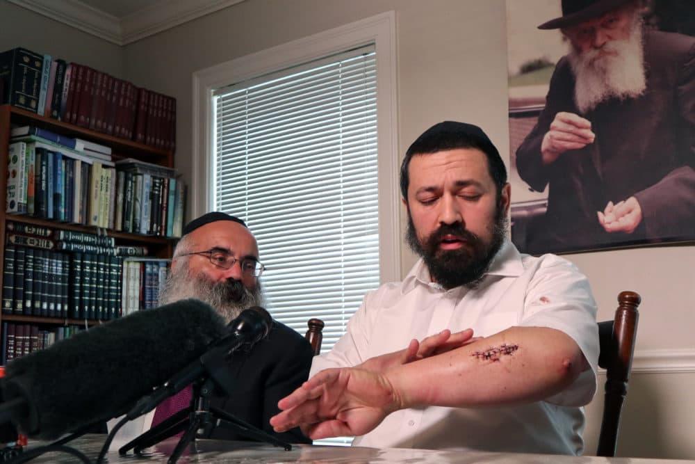 Rabbi Shlomo Noginski, right, sits with Rabbi Dan Rodkin in his Brighton home on Sunday. (Adrian Ma/WBUR)