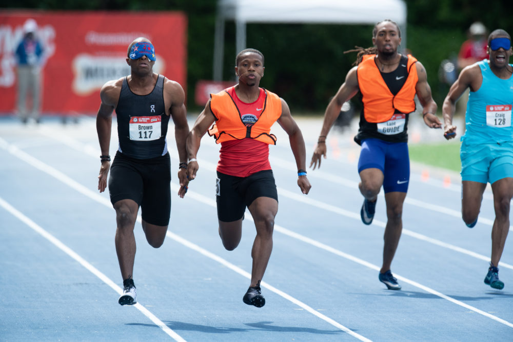 David Brown, left, and guide Moray Steward win the 100 Meter Dash Saturday, June 19, 2021 at the U.S. Paralympic Team Trials for Track and Field in Minneapolis. (Mark Reis)