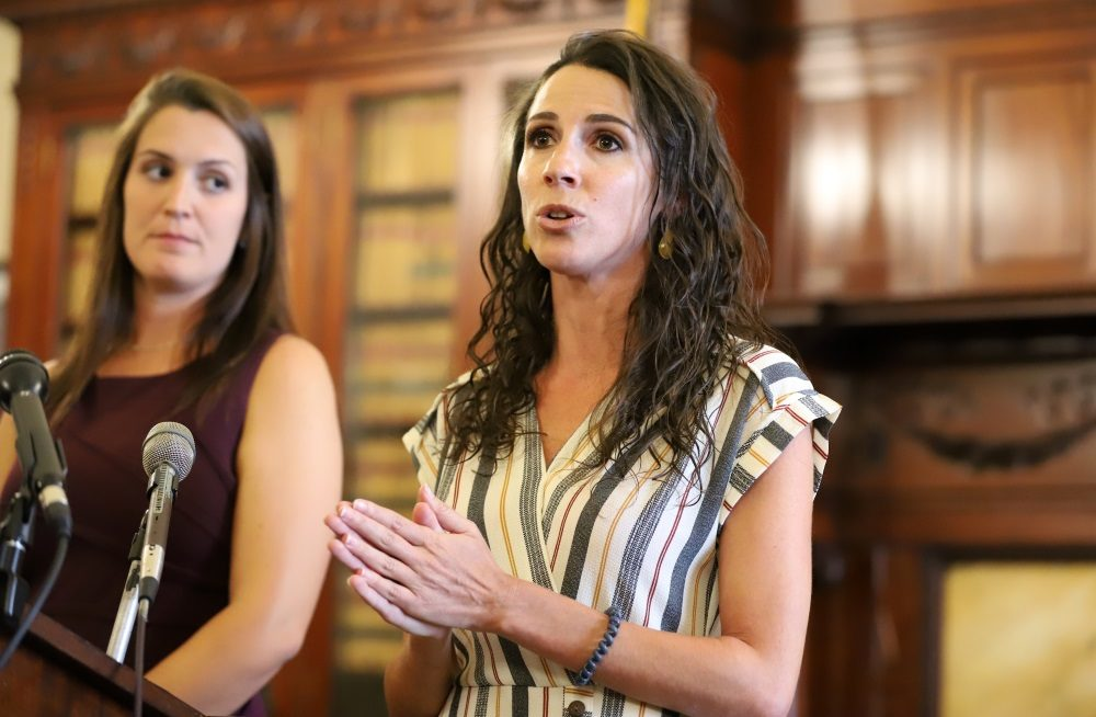 """Sen. Diana DiZoglio (right), who filed legislation to increase State House employee pay and remove a waiting period legislative staffers face to access health insurance benefits, said the delayed health coverage new hires faced during the pandemic was """"simply unacceptable."""" (Sam Doran/SHNS)"""