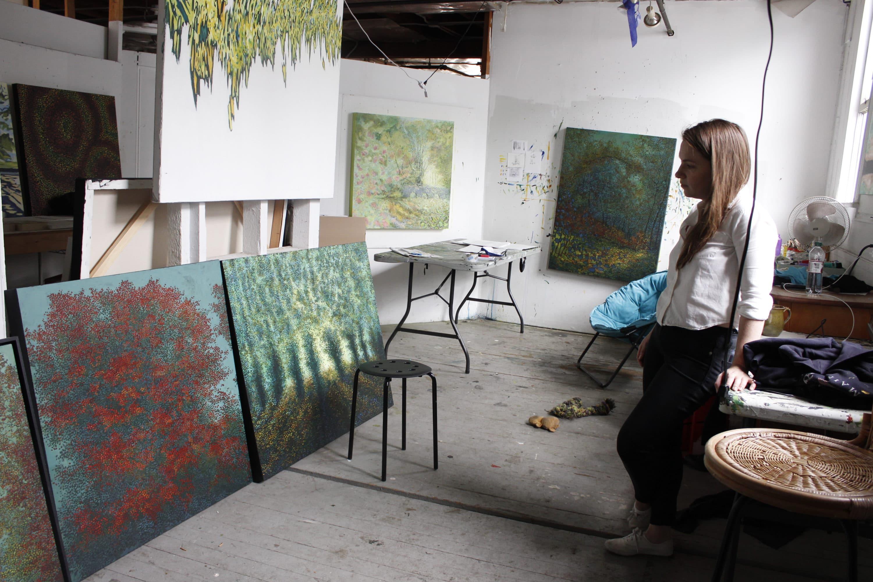 Painter Bethany Noël in her art studio at 57 Central St. in Somerville. (Jenn Stanley for WBUR)