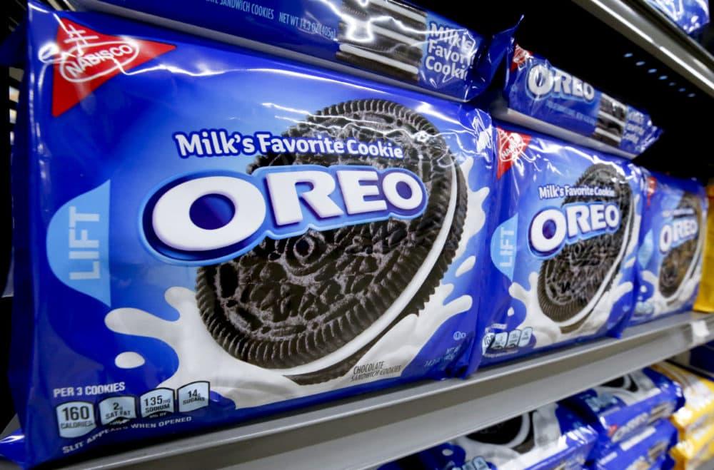 Packages of Nabisco Oreo cookies line a shelf in a market. (Gene J. Puskar/AP)