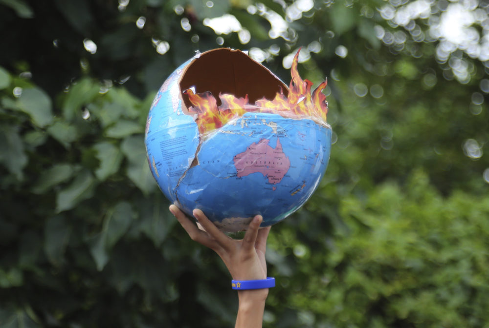 A girl holds a globe as she participates in a protest calling for action against climate change in Mumbai, India, Friday, Sept. 27, 2019. (Rafiq Maqbool/AP)