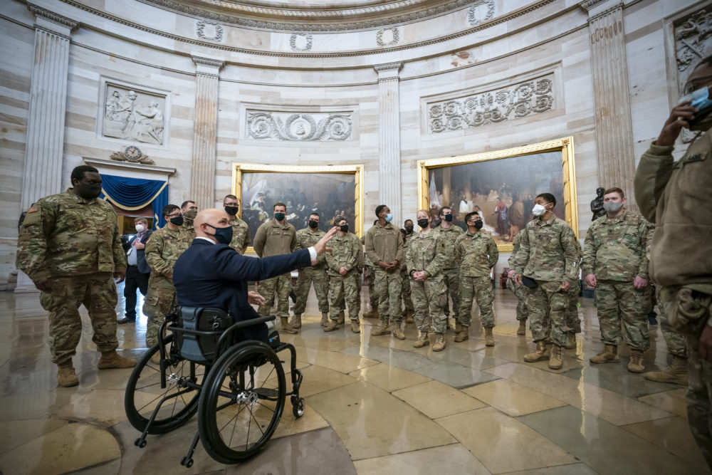 Rep. Brian Mast, R-Fla., left, visits with National Guard troops who are helping with security at the Capitol Rotunda in Washington, D.C., on Jan. 13, 2021. (J. Scott Applewhite/AP)