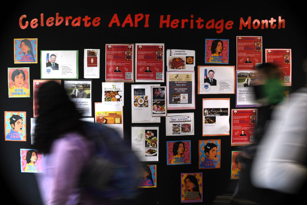 Students walk past a display for Asian Pacific American Heritage Month at Farmington High School in Farmington, Conn on May 10, 2021. The year of anti-Asian violence has led students and teachers to advocate for reexamining how Asian American studies and history are taught in public schools. (Jessica Hill/AP)