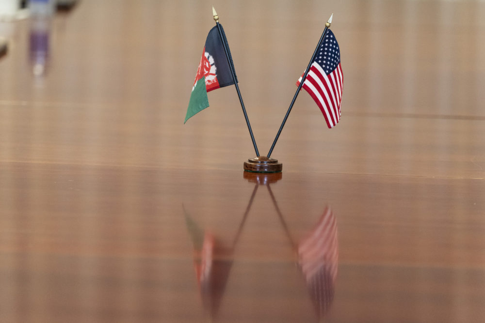 The flags of Afghanistan and the United States are seen on the table before a meeting between the Secretary of Defense Lloyd Austin and Afghan President Ashraf Ghani at the Pentagon in Washington, D.C., on June 25, 2021. (Alex Brandon/AP)