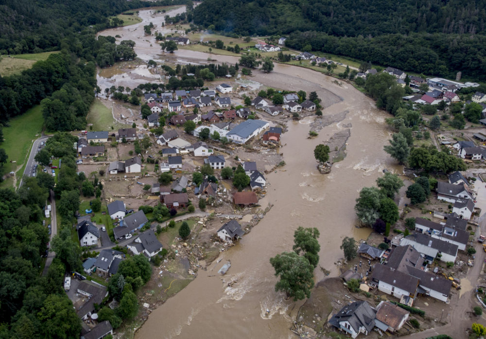 July 15, 2021: The Ahr river floats past destroyed houses in Insul, Germany.  Due to heavy rain falls, the Ahr river dramatically went over the banks the evening before. The mayors of three German towns badly hit by July's deadly floods are appealing for more help from the state and federal governments, saying the disaster caused billions of euros worth of damage. (Michael Probst/AP/File)