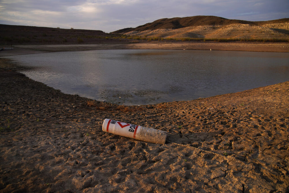 A buoy rests on the ground at a closed boat ramp on Lake Mead at the Lake Mead National Recreation Area, Friday, Aug. 13, 2021, near Boulder City, Nev. (AP Photo/John Locher)