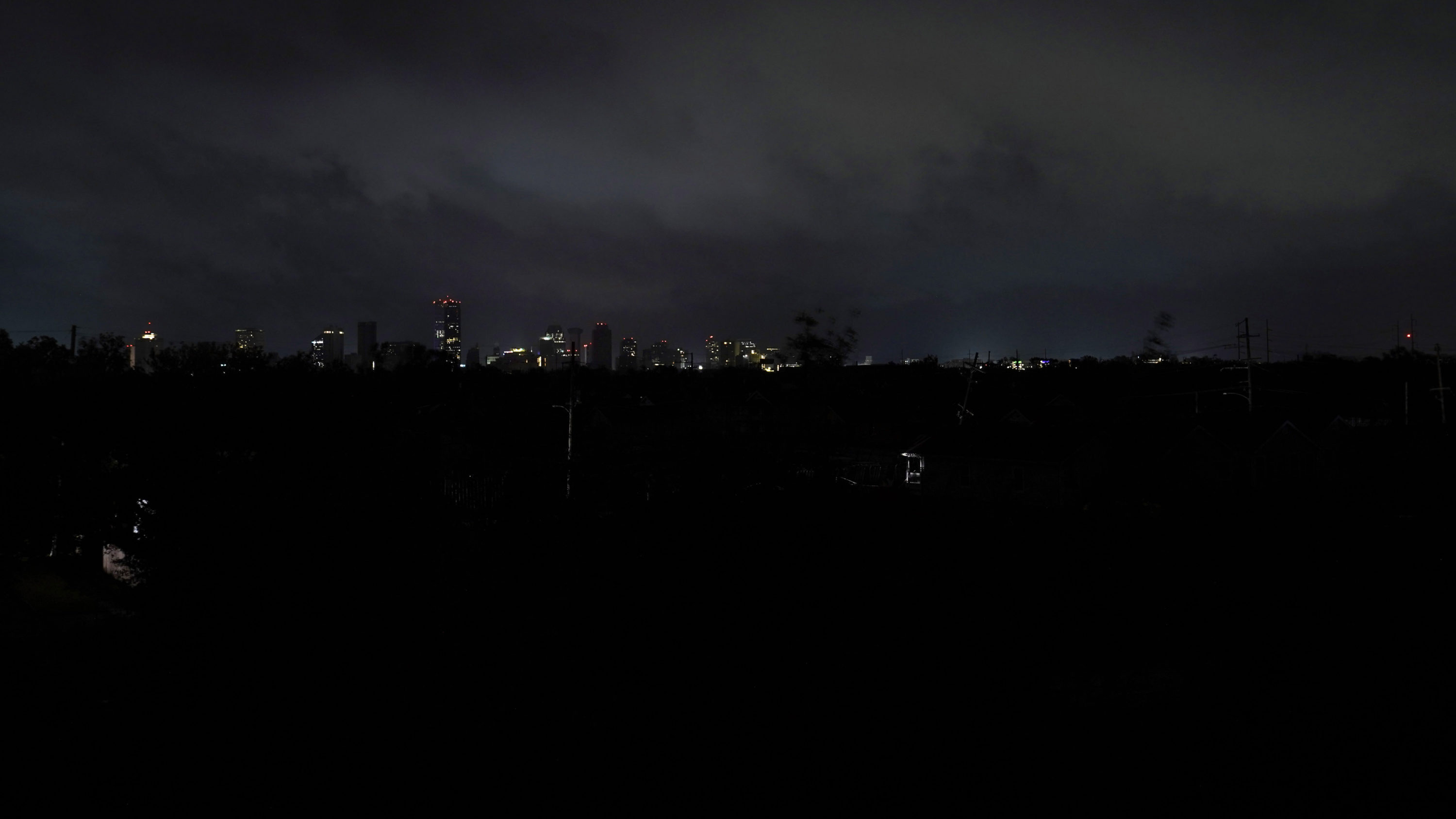 Downtown buildings relying on generator power are seen as the entire city of New Orleans is without power in the aftermath of Hurricane Ida in New Orleans, Monday, Aug. 30, 2021. (Gerald Herbert/AP Photo)