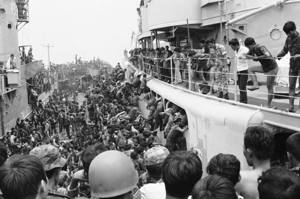 South Vietnamese Marines leap in panic aboard a cutter from an LST in Danang Harbor in Da Nang, Vietnam, on April 1, 1975 as they are evacuated from the city, shortly before its fall to the Viet Cong and North Vietnamese. Cutters in turn hauled them south to Cam Ranh Bay. (AP Photo)