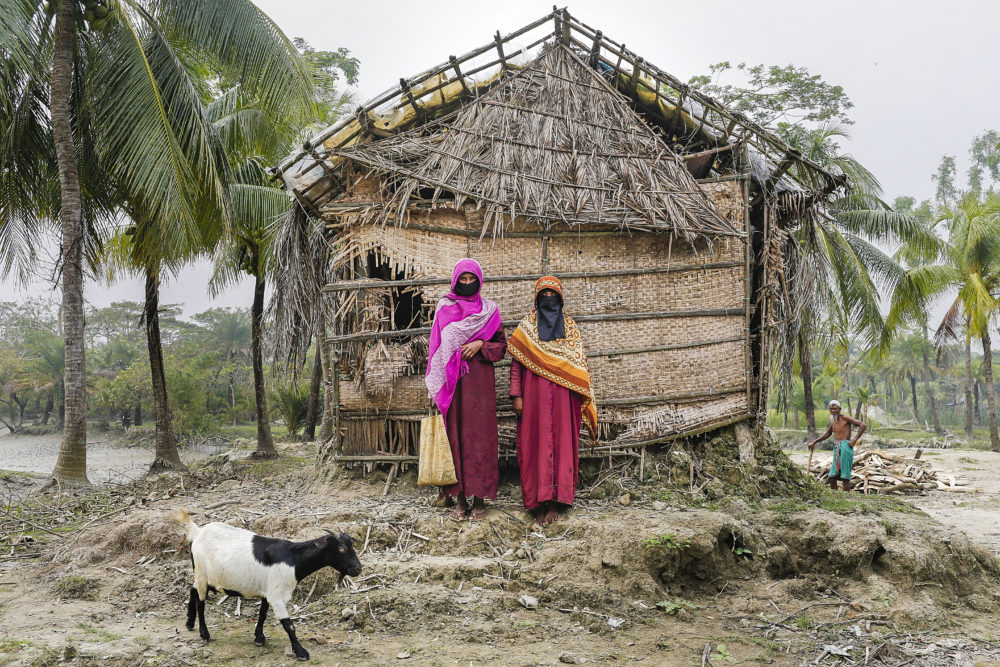 Nurun Nahar, right, lost her husband along with her belongings to the rising of the River Meghna in Bangladesh. (Shahria Sharmin/AP)