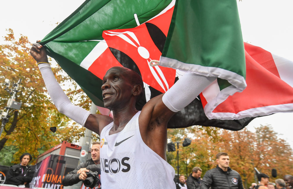 Eliud Kipchoge celebrates breaking the two hour barrier for a marathon distance with supporters and his team on the Hauptallee. (Thomas Lovelock for The INEOS 1:59 Challenge)