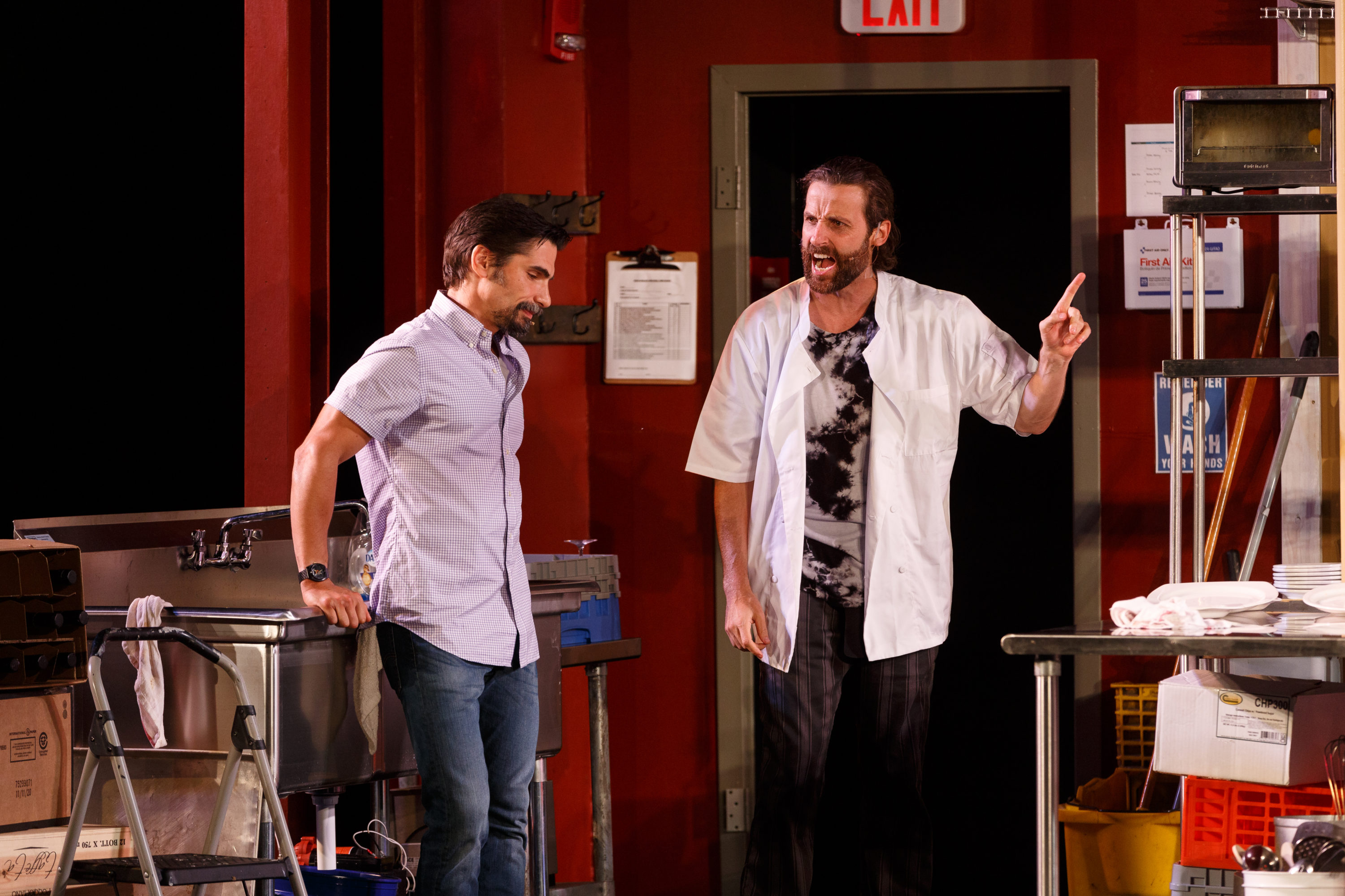 """Matt Monaco and James Louis Wagner argue about the philosophy of cooking in Theresa Rebeck's """"Seared."""" Gloucester Stage Company is producing the play at Windhover Arts Center in Rockport. (Courtesy Jason Grow)"""