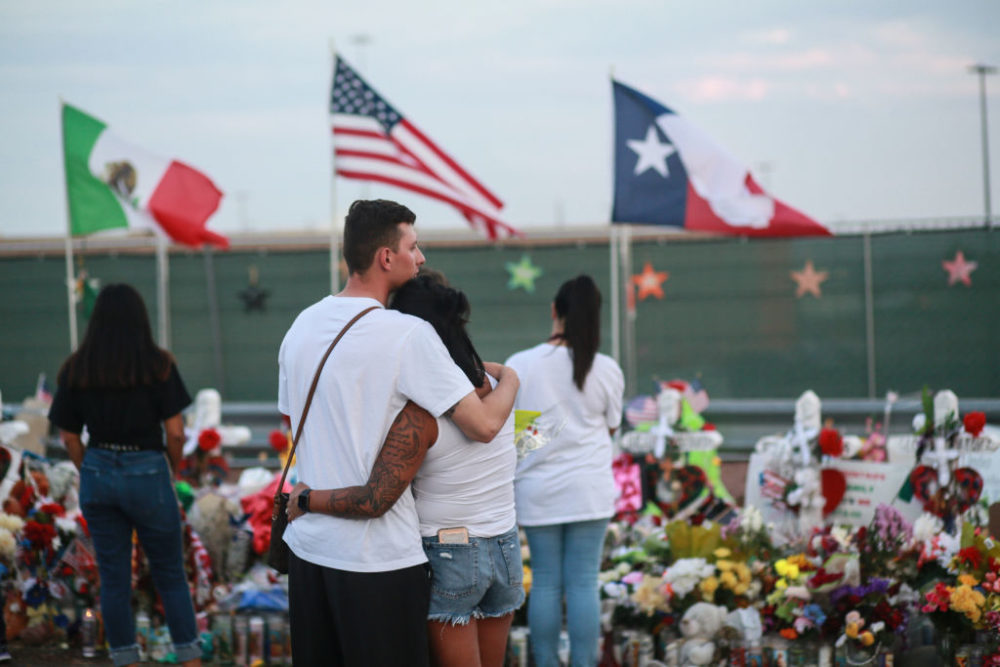 People gather at a makeshift memorial honoring victims outside Walmart on August 15, 2019 in El Paso, Texas. Twenty-two people were killed in the Walmart during a mass shooting on August 3. (Sandy Huffaker/Getty Images)
