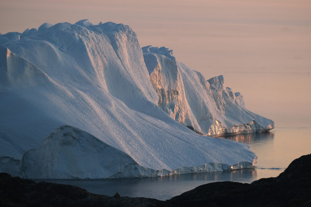 A massive iceberg stands at the mouth of the Ilulissat Icefjord during a week of unseasonably warm weather on Aug. 4, 2019 near Ilulissat, Greenland. (Sean Gallup/Getty Images)