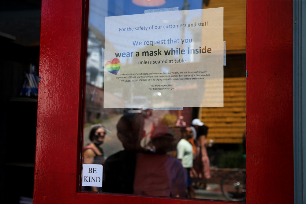 A sign at the Heaven Cafe encourages customers to wear masks until seated in Provincetown on July 24, 2021. (Craig F. Walker/The Boston Globe via Getty Images)