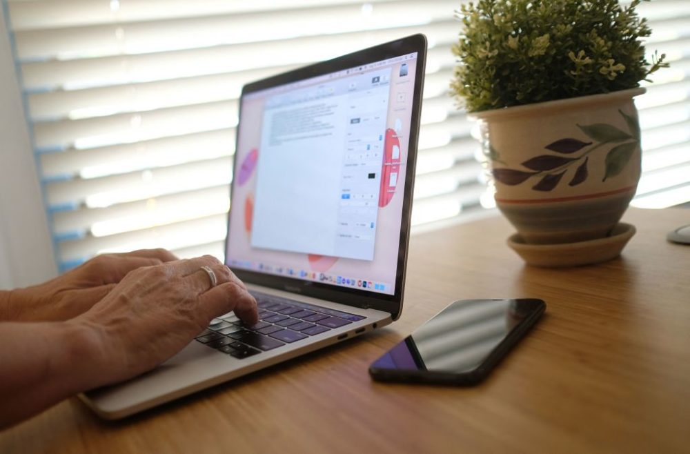 A person working on their laptop from a home office in Los Angeles on Aug. 13, 2021. (Chris Delmas/AFP/Getty Images)
