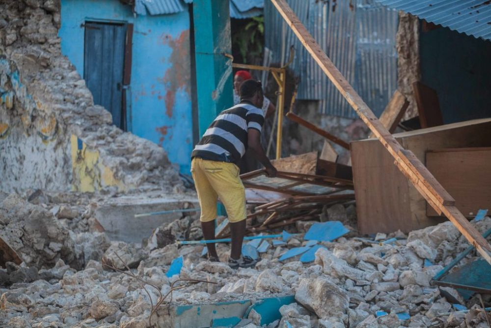 A man recovers what he can after a 7.2-magnitude earthquake struck Haiti. (Richard Pierrin/Getty Images)