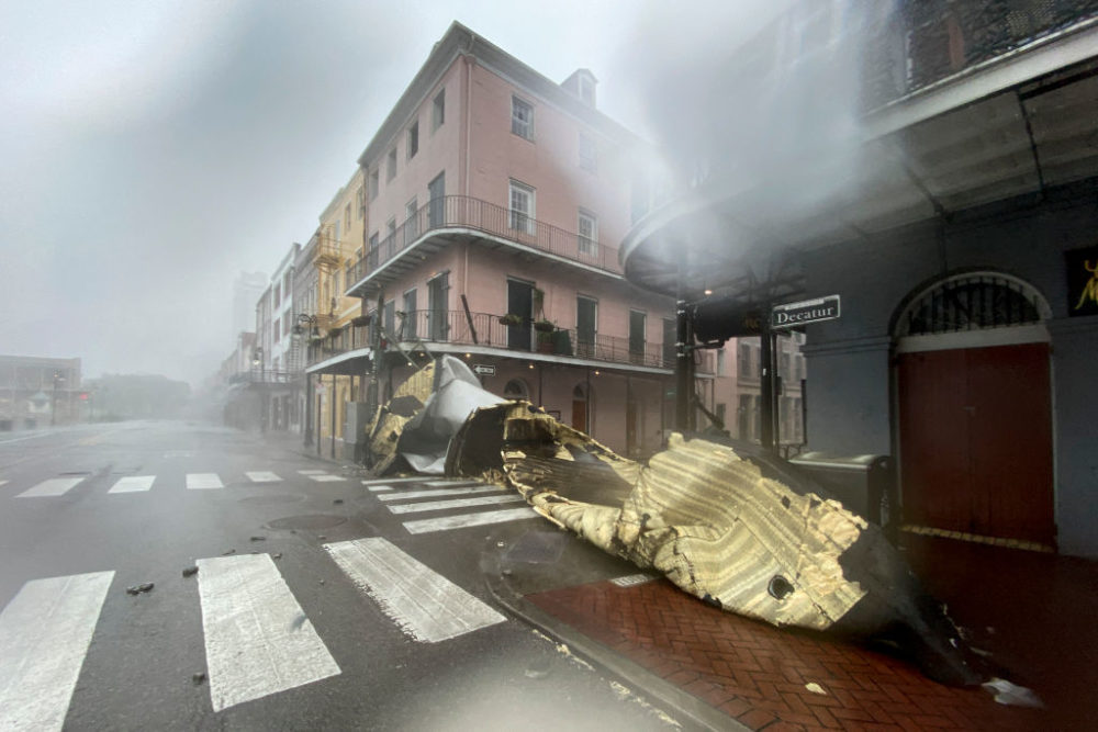 A section of a building's roof is seen after being blown off during rain and winds in the French Quarter of New Orleans, Louisiana, on Aug. 29, 2021 during Hurricane Ida. (Patrick T. Fallon/AFP/Getty Images)