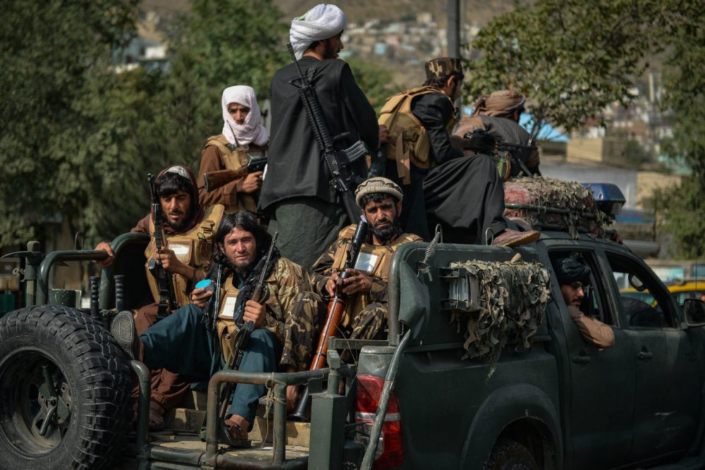 Taliban fighters patrol along a street in Kabul on Aug. 31, 2021. The Taliban joyously fired guns into the air and offered words of reconciliation as they celebrated defeating the United States and returning to power after two decades of war that devastated Afghanistan. (Hoshang Hashimi/AFP via Getty Images)