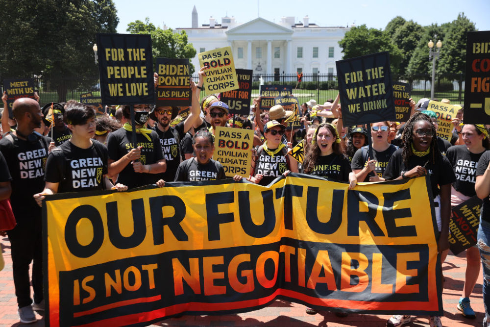Hundreds of young climate activists  rally in Lafayette Square on the north side of the White House to demand that U.S. President Joe Biden work to make the Green New Deal into law on June 28, 2021 in Washington, DC. Organized by the Sunrise Movement, the 'No Climate, No Deal' marchers demanded a meeting with Biden to insist on an 'infrastructure package that truly invests in job creation and acts to combat the climate crisis.' (Chip Somodevilla/Getty Images)