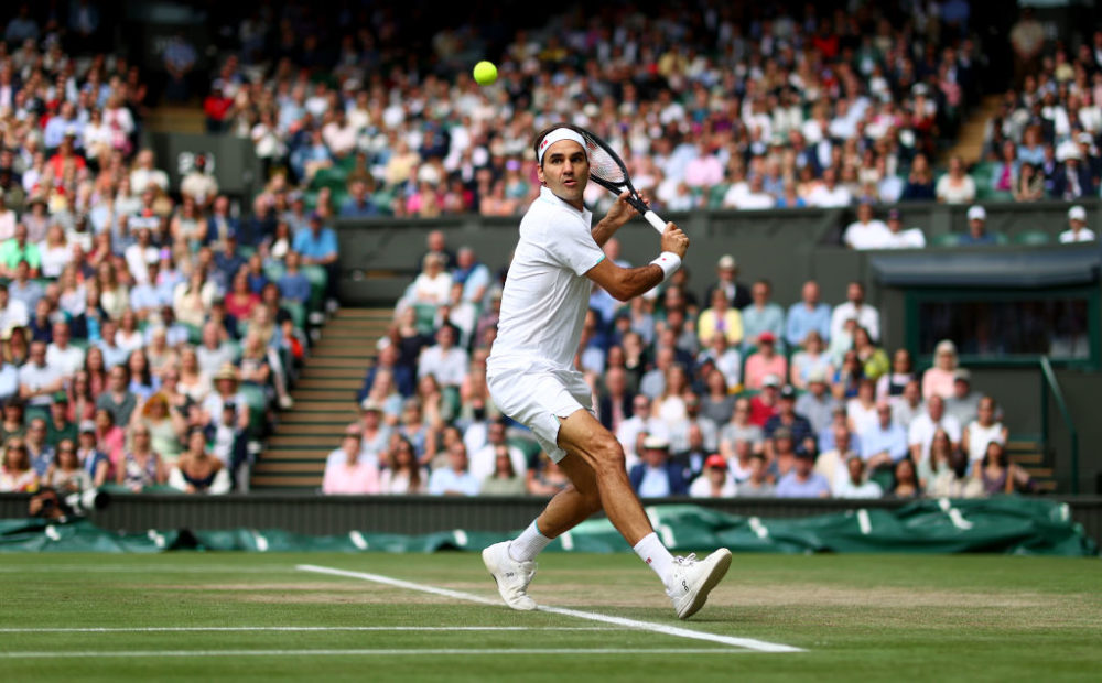 Roger Federer plays a backhand during his men's Singles Quarter Final match against Hubert Hurkacz during The Championships - Wimbledon 2021 at All England Lawn Tennis and Croquet Club on July 7, 2021 in London, England. (Julian Finney/Getty Images)