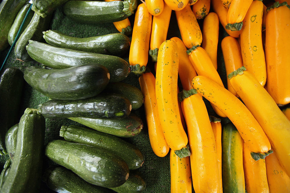 Zucchini is almost always dark green and grows fairly straight in shape, while yellow summer squash tends to be yellow and slightly bulbous on the bottom. They are very similar in taste and texture and can be used interchangeably. (Mario Tama/Getty Images)