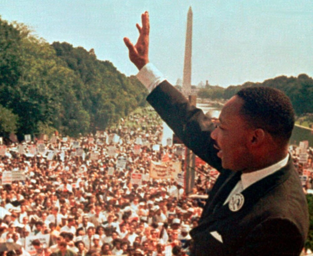 """Dr. Martin Luther King Jr. acknowledges the crowd at the Lincoln Memorial for his """"I Have a Dream"""" speech during the March on Washington, D.C. in this file photo of Aug. 28, 1963. (AP)"""