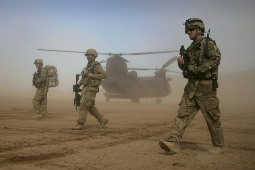 In this Jan. 28, 2012 file photo, U.S. soldiers patrol west of Kabul, Afghanistan. As the U.S. ends the war in Afghanistan and as the Taliban recapture much of the country, Americans are asking if the longest war in their history was worth the cost. (Hoshang Hashimi/AP file photo)