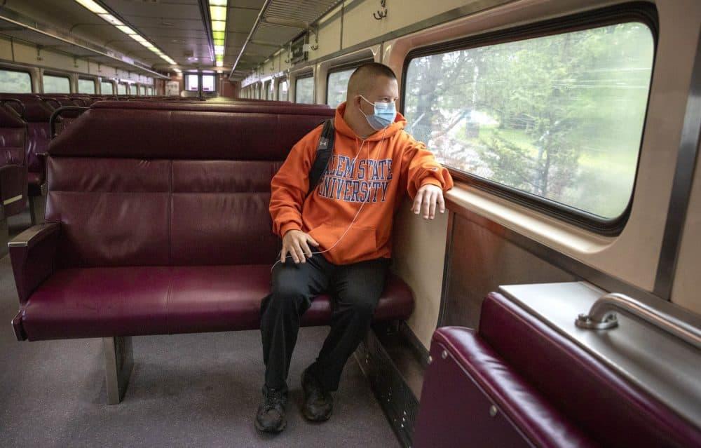 Matthew Cullen rides the MBTA Commuter Rail from Ipswich to Newburyport. (Robin Lubbock/WBUR)
