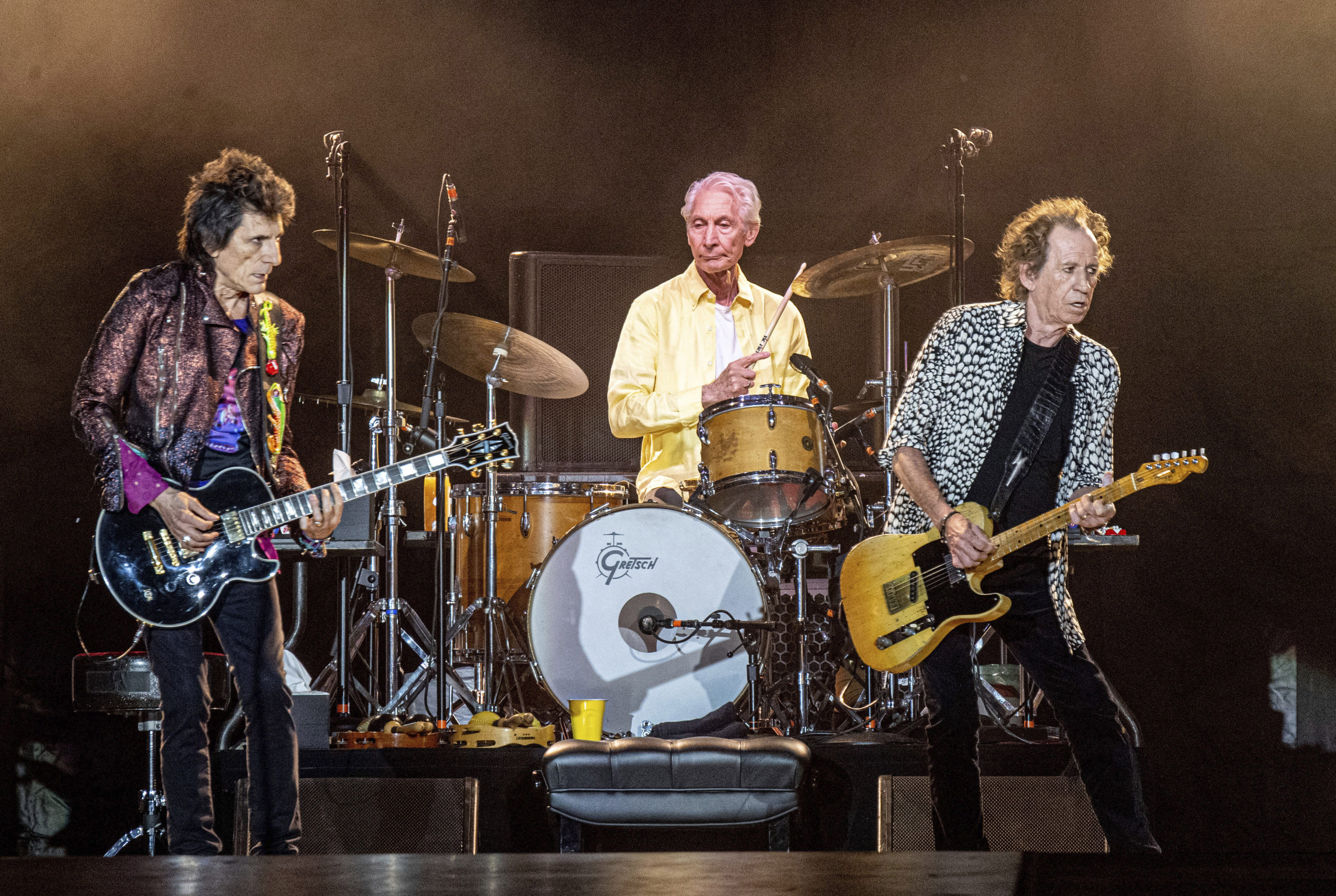 From left, Ronnie Wood, Charlie Watts and Keith Richards of The Rolling Stones perform on July 15, 2019, in New Orleans. Watts' publicist, Bernard Doherty, said Watts passed away peacefully in a London hospital surrounded by his family on Tuesday, Aug. 24, 2021. He was 80. (Amy Harris/Invision/AP)