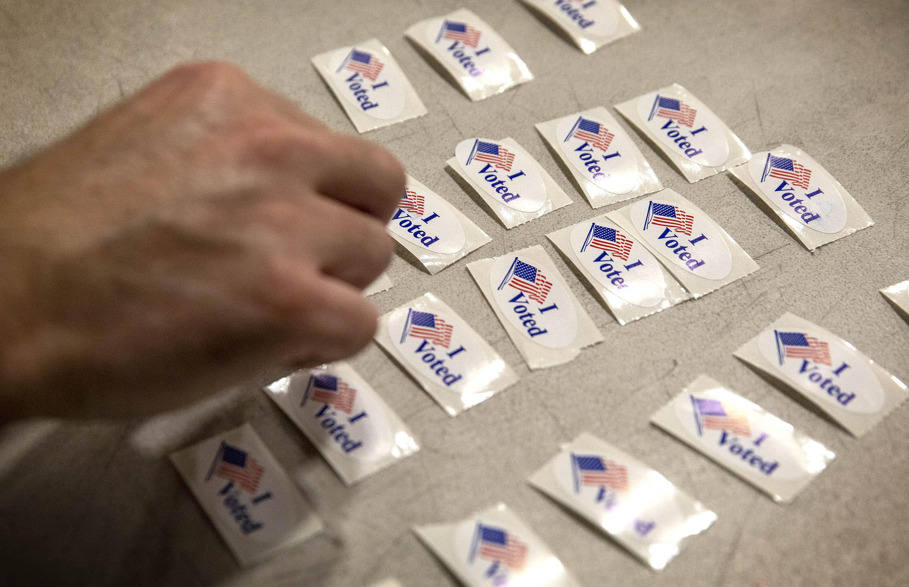 """""""I voted"""" stickers at the Wang YMCA voting location in Boston's Chinatown. (Robin Lubbock/WBUR)"""