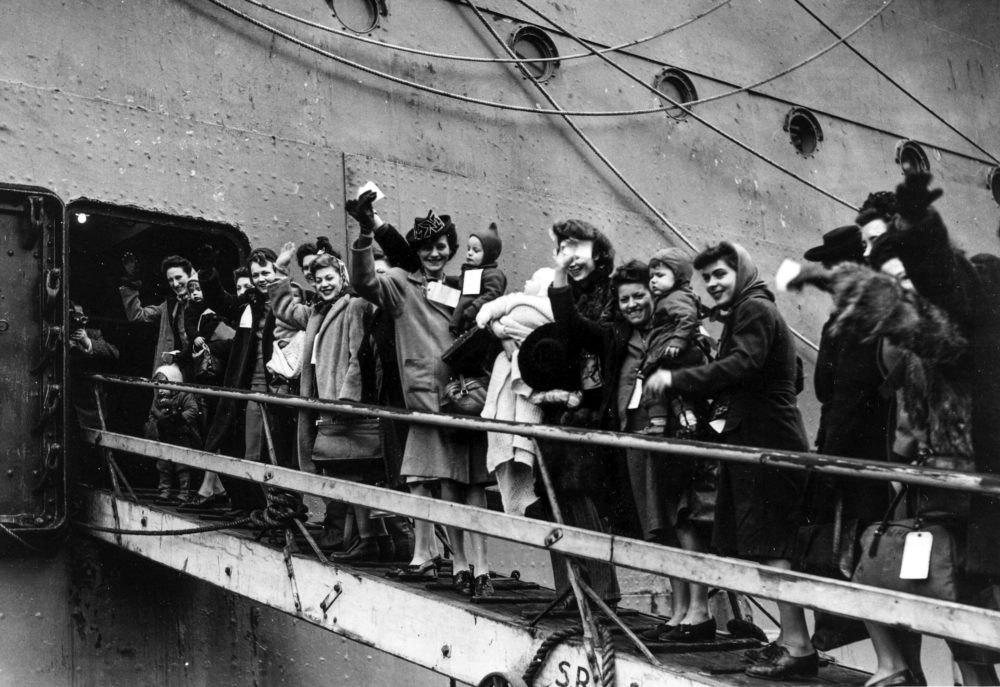 British women known as GI brides going up the gangplank of the S.S. Argentina to start the journey to America and a new life with their American husbands in 1946. (Popperfoto via Getty Images/Getty Images)