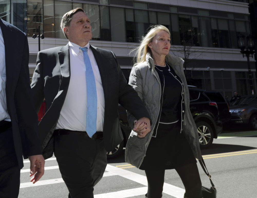 In this April 3, 2019 file photo, investor John Wilson, left, arrives at federal court in Boston with his wife Leslie to face charges in a nationwide college admissions bribery scandal. (Charles Krupa/AP File)